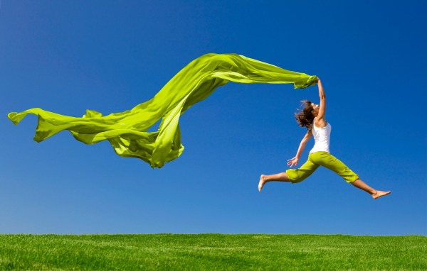 Lady with green material in the wind